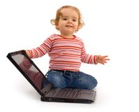 Baby girl with laptop. Understanding computer technology, the basics - one year old girl - future businesswoman - with laptop Stock Images