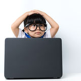 Baby girl with laptop Stock Photography