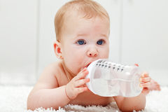 Baby girl with large water bottle Royalty Free Stock Photos