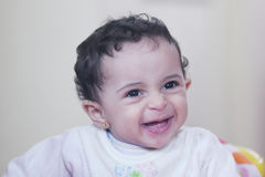 Baby girl laughing. Arabian egyptian newborn baby girl laughing in baby car in egypt Stock Image