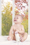 Baby girl laughing on bedroom Royalty Free Stock Images