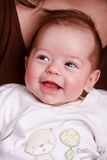 Baby girl laughing with toothless smile Stock Photo