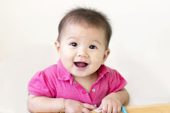 Baby girl laughs Royalty Free Stock Photo