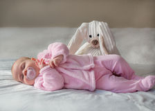 Baby girl. Laying on side sleeping with teddy bear royalty free stock images