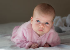 Baby girl. Laying on stomach looking up royalty free stock images