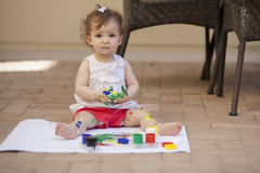 Baby girl learning to paint Royalty Free Stock Images