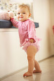 Baby Girl Learning To Stand Up At Home Stock Image
