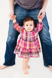 Baby girl learning to walk royalty free stock images
