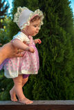 Baby girl learning to walk. First steps Royalty Free Stock Photography