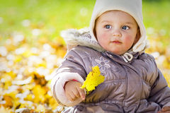 Baby girl with leave Royalty Free Stock Photos