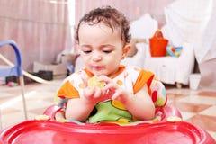 Baby girl with lemon Stock Image