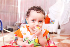 Baby girl with lemon Royalty Free Stock Images