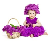 Baby Girl with Lilac Flowers, Child Fashion Portrait on White stock photos