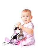Baby girl listening music Royalty Free Stock Photo