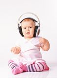 Baby girl listening music Stock Image