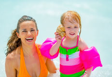 Free Baby Girl Listening Sound Of Sea In Shell Royalty Free Stock Photo - 44216855