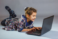 Baby girl looking computer and smiling. Baby girl looking at computer and smiling Royalty Free Stock Photo