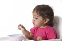 Baby girl is looking at the food Royalty Free Stock Image
