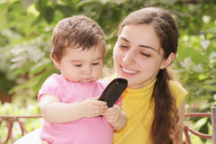 Baby girl looking at phone receiver Royalty Free Stock Images