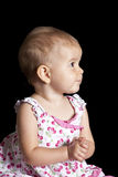 Baby girl looking to side Royalty Free Stock Image