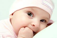 Baby girl looks Stock Photography