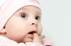 Baby girl looks unconcerned  Royalty Free Stock Image