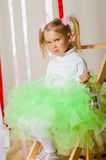 Baby girl in lush color skirt Stock Photos