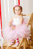 Baby girl in lush color skirt Stock Image