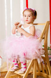Baby girl in lush color skirt Stock Images
