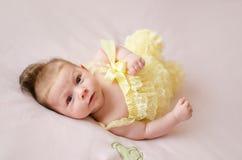 Baby girl lying on back Stock Image