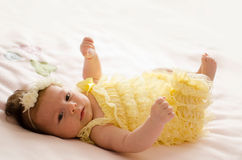 Baby girl lying on back Royalty Free Stock Images