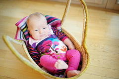 Baby girl lying in a basket Stock Photography