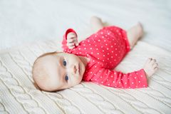 Baby girl lying on bed in nursery Royalty Free Stock Photos