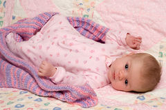 Baby Girl Lying on Blanket Royalty Free Stock Image