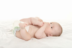 Baby girl lying on blanket Royalty Free Stock Photos