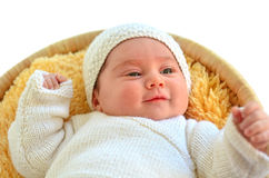 Baby girl lying down in basket stock images