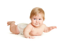 Baby girl lying face-down position. Child lying face-down position Stock Photo