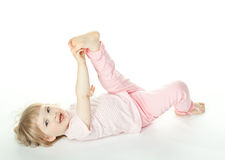 The baby girl is lying on the floor Stock Images