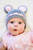 Baby girl lying on her back and smiling Royalty Free Stock Photos