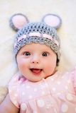 Baby girl lying on her back and smiling Stock Photo