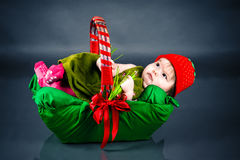 Baby girl lying in the image of berries Stock Photo