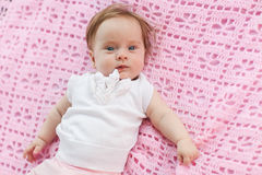 Baby girl. Lying on a pink bract Royalty Free Stock Images