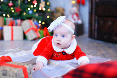 Baby girl lying on plaid and looking to side in New Year's studi Stock Photo