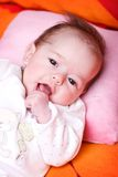 Baby girl lying on a soft blanket and watching Royalty Free Stock Image