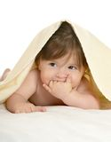 Baby girl lying under blanket Royalty Free Stock Photography