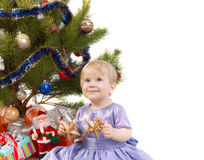 Baby girl make a wish under Christmas tree royalty free stock photo