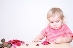 Baby girl making autumn composition Stock Photo