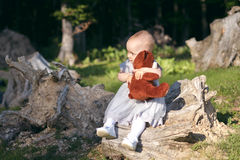 Baby girl making cute face in the outdoors Stock Photos