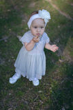 Baby girl making cute face in the outdoors Stock Image