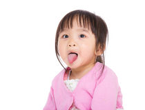 Baby girl making funny face Stock Image